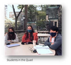 students in the quad wearing masks